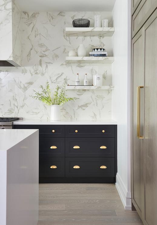 brass-cup-pulls-on-black-kitchen-drawers